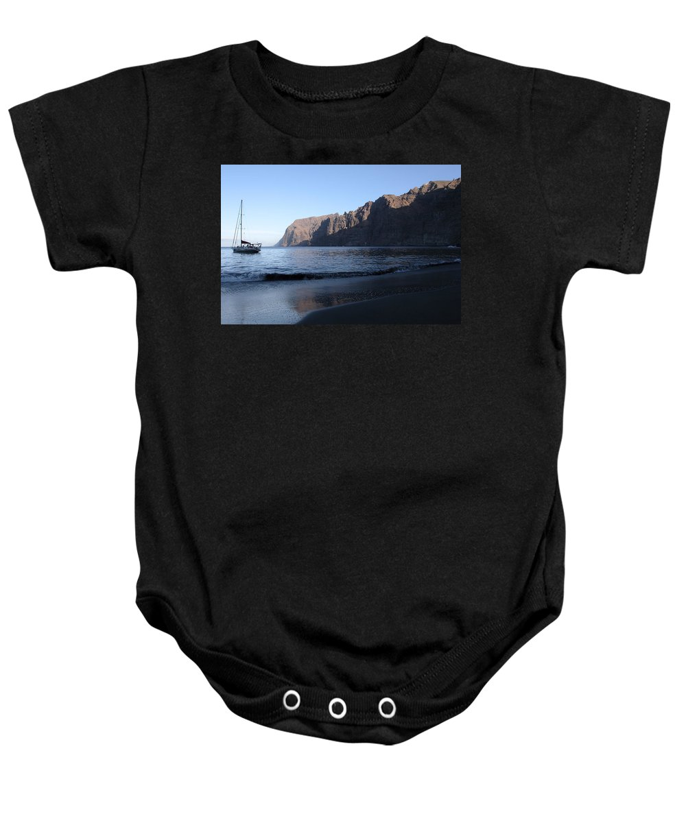 Seascape Baby Onesie featuring the photograph Los Gigantes Yacht by Phil Crean