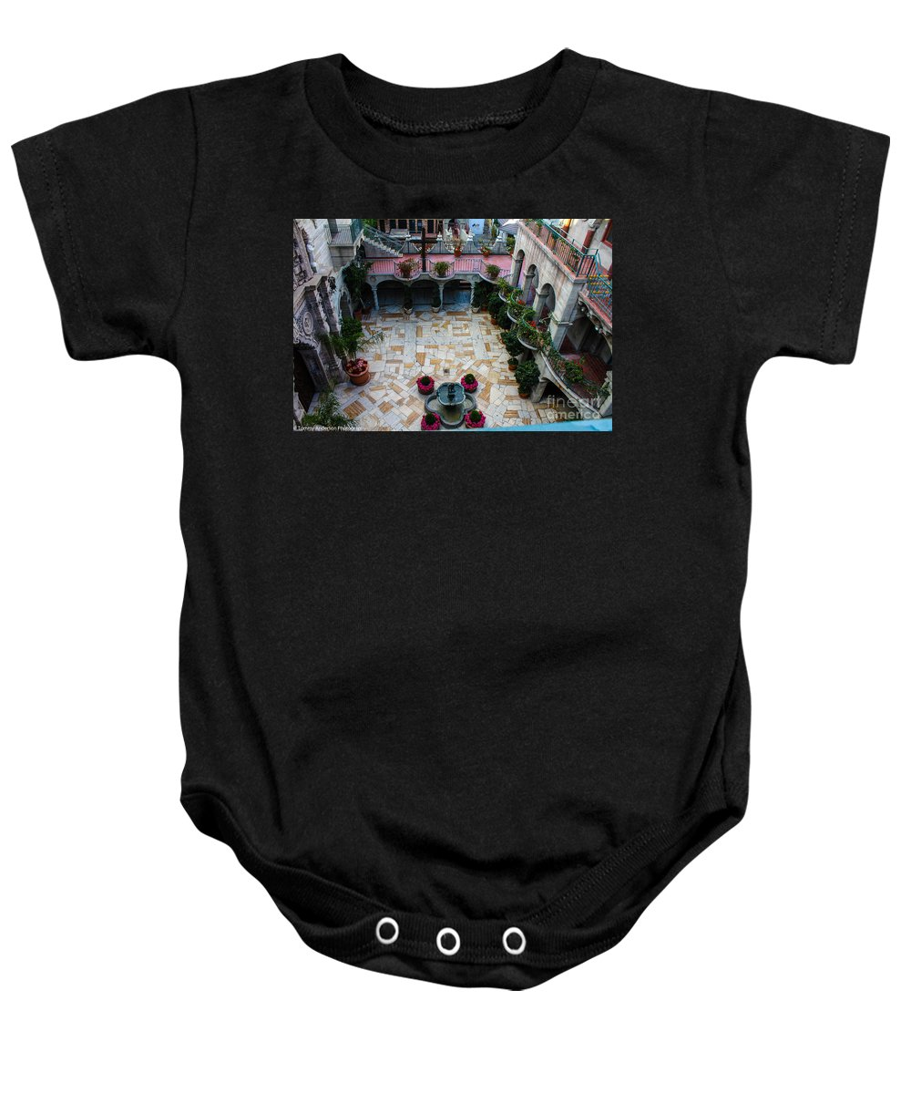 Mission Inn Baby Onesie featuring the photograph Mission Inn Chapel Court Yard by Tommy Anderson