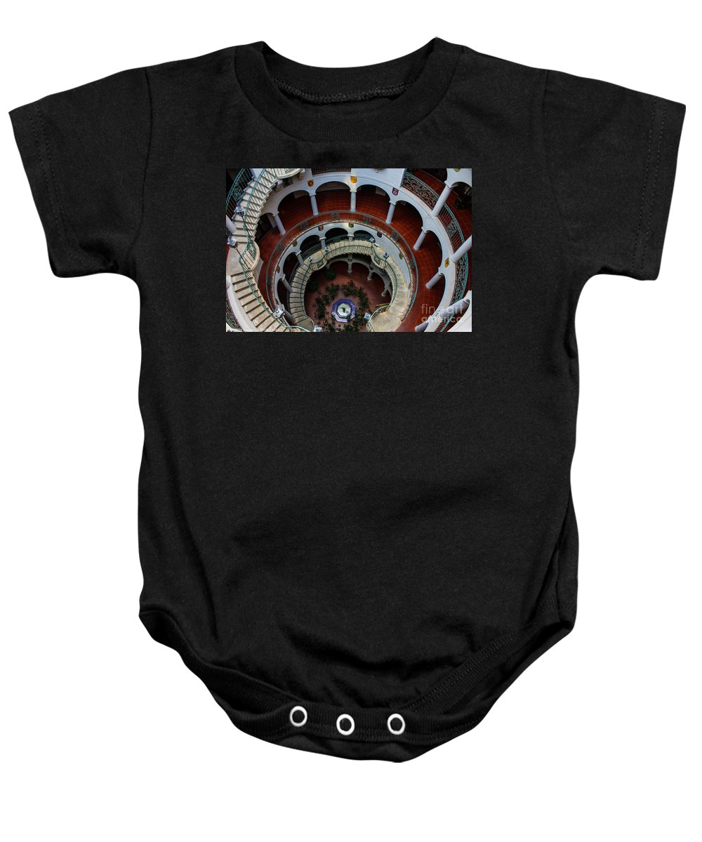 Mission Inn Baby Onesie featuring the photograph Mission Inn Circular Stairway by Tommy Anderson