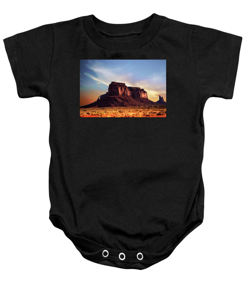 Monument Valley Baby Onesie featuring the photograph Monument Valley sunset by Roy Nierdieck