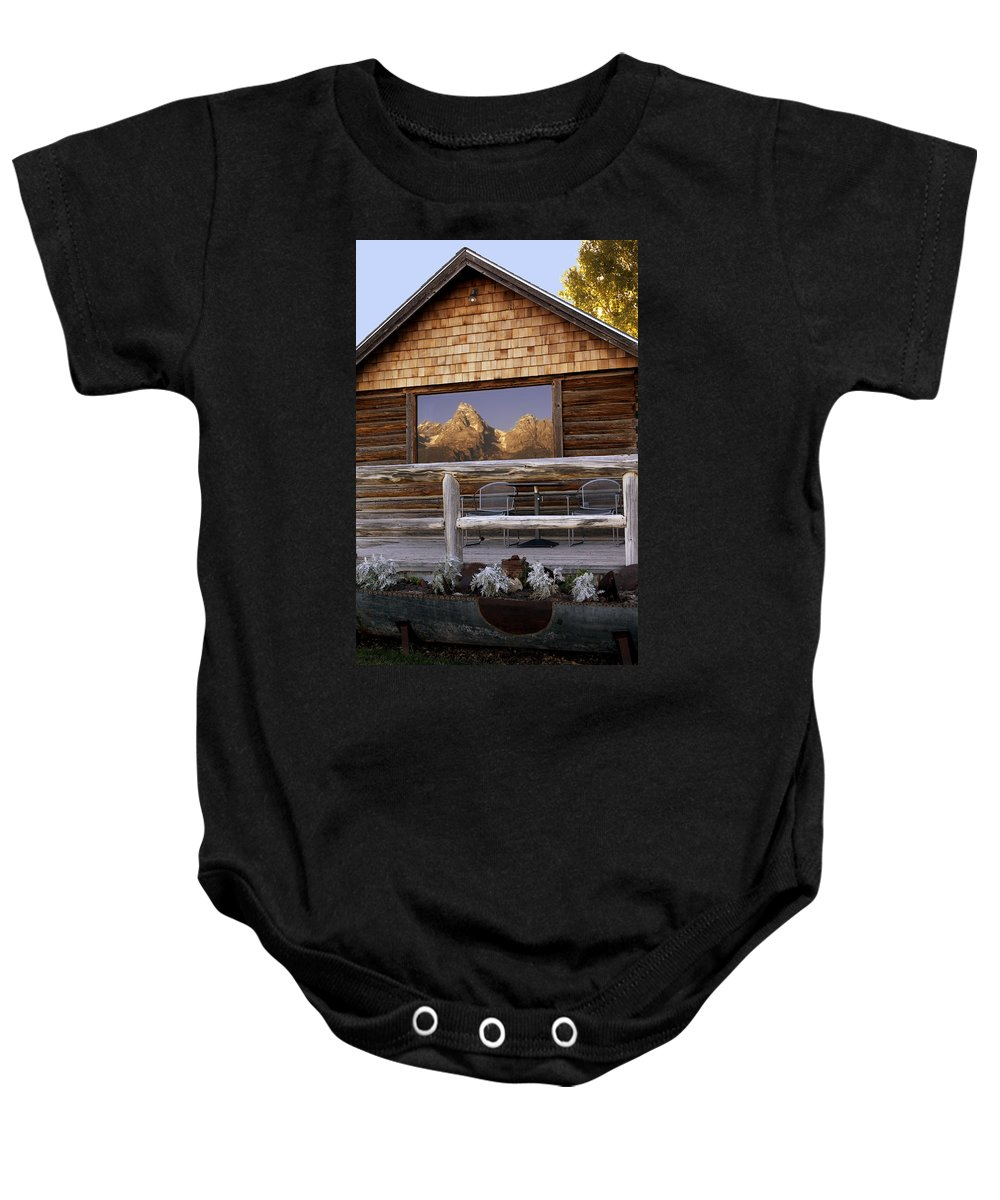 Late Snow Baby Onesie featuring the photograph Moulton Ranch Cabin Reflection Grand Tetons by Gary Langley
