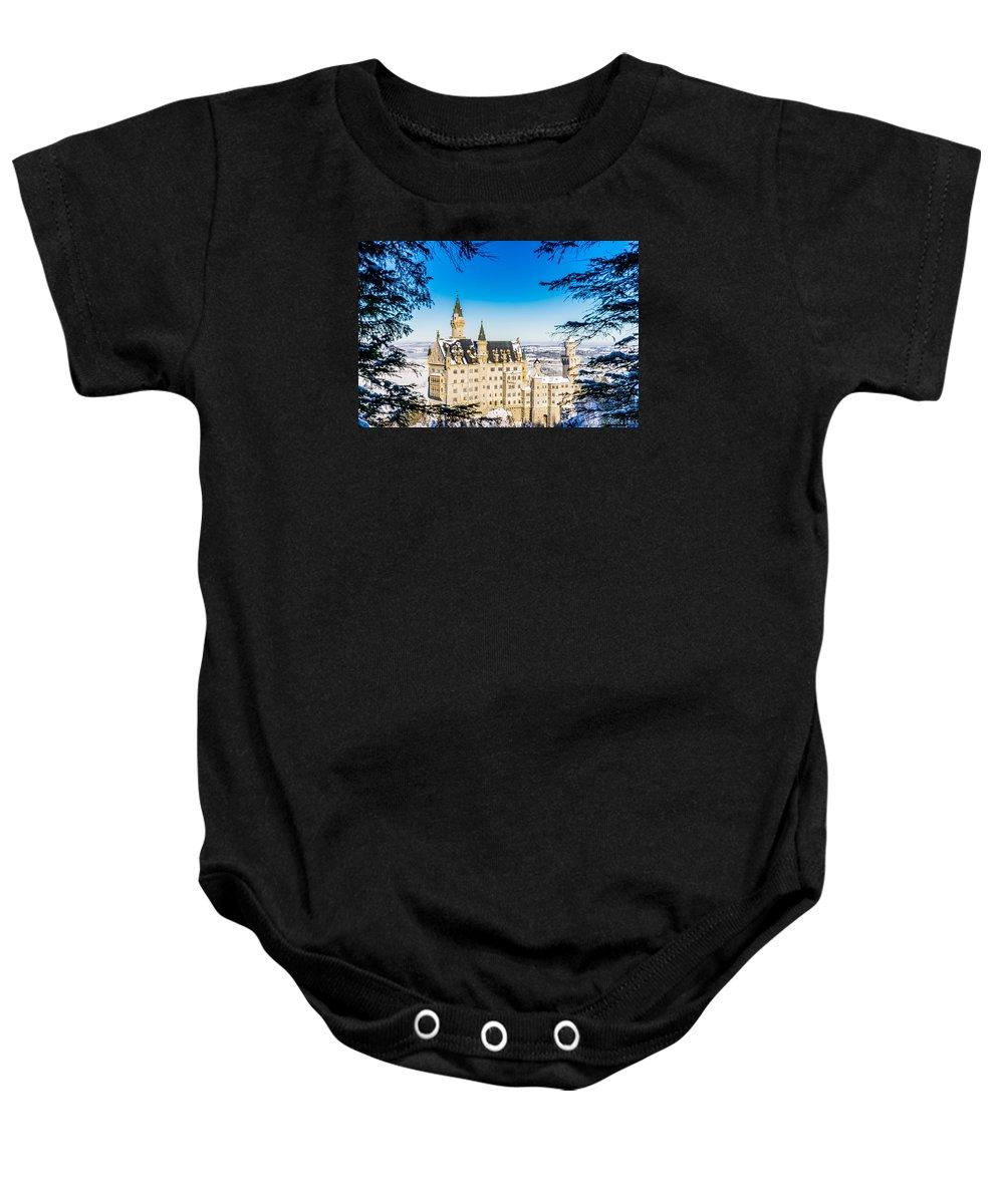 Neuschwanstein Baby Onesie featuring the photograph Neuschwanstein Castle by Alpha Wanderlust