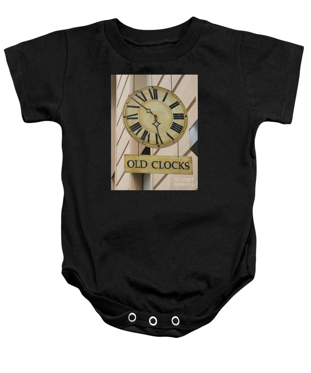Clock Baby Onesie featuring the photograph Old Clocks by Ann Horn