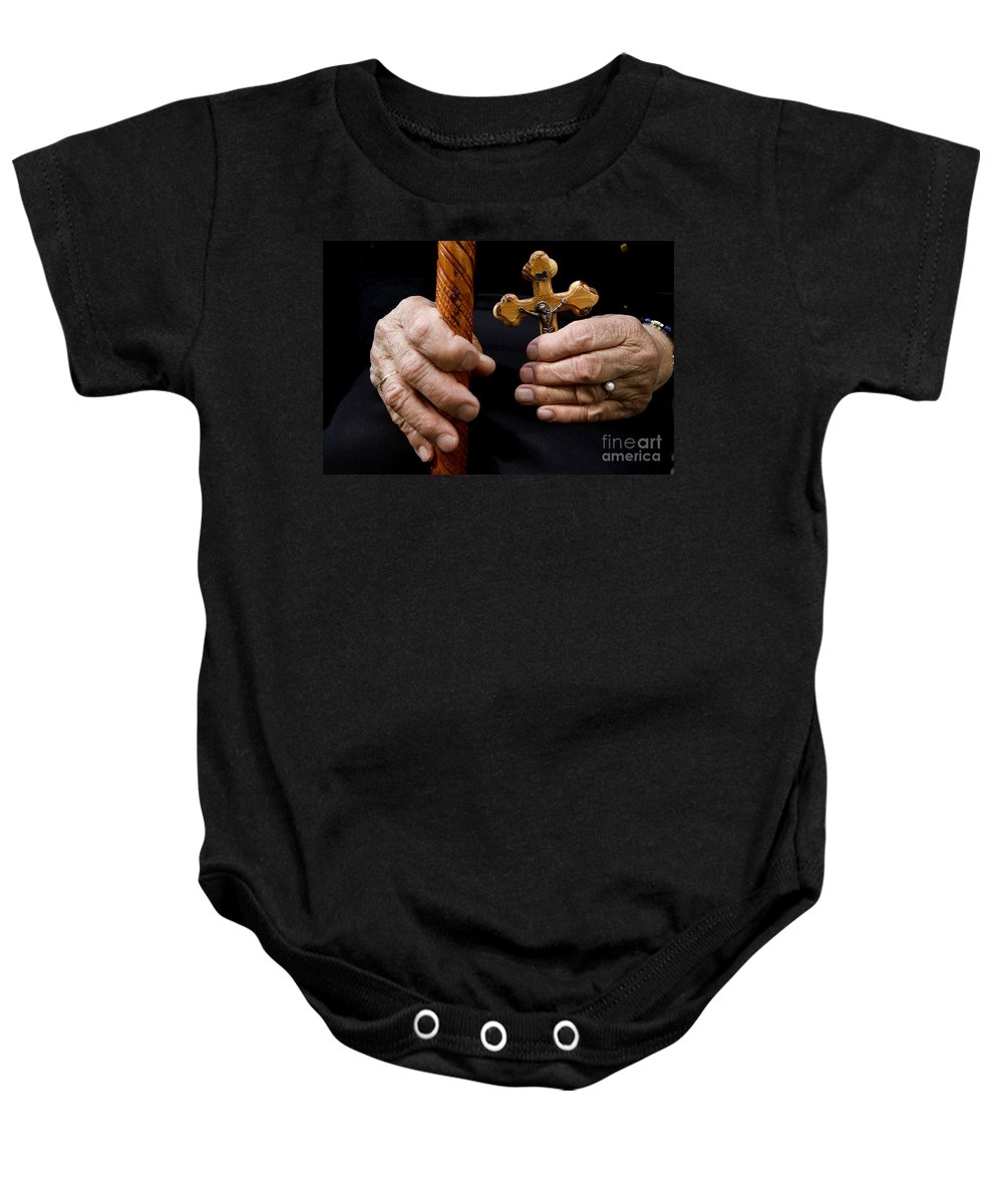 Old Baby Onesie featuring the photograph Old Hands And Crucifix by Danny Yanai