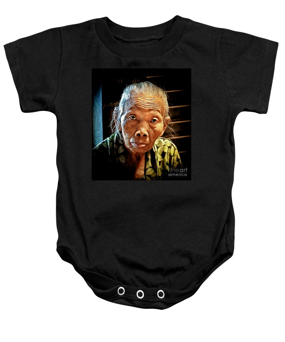 Baby Onesie featuring the photograph Old Lady by Charuhas Images