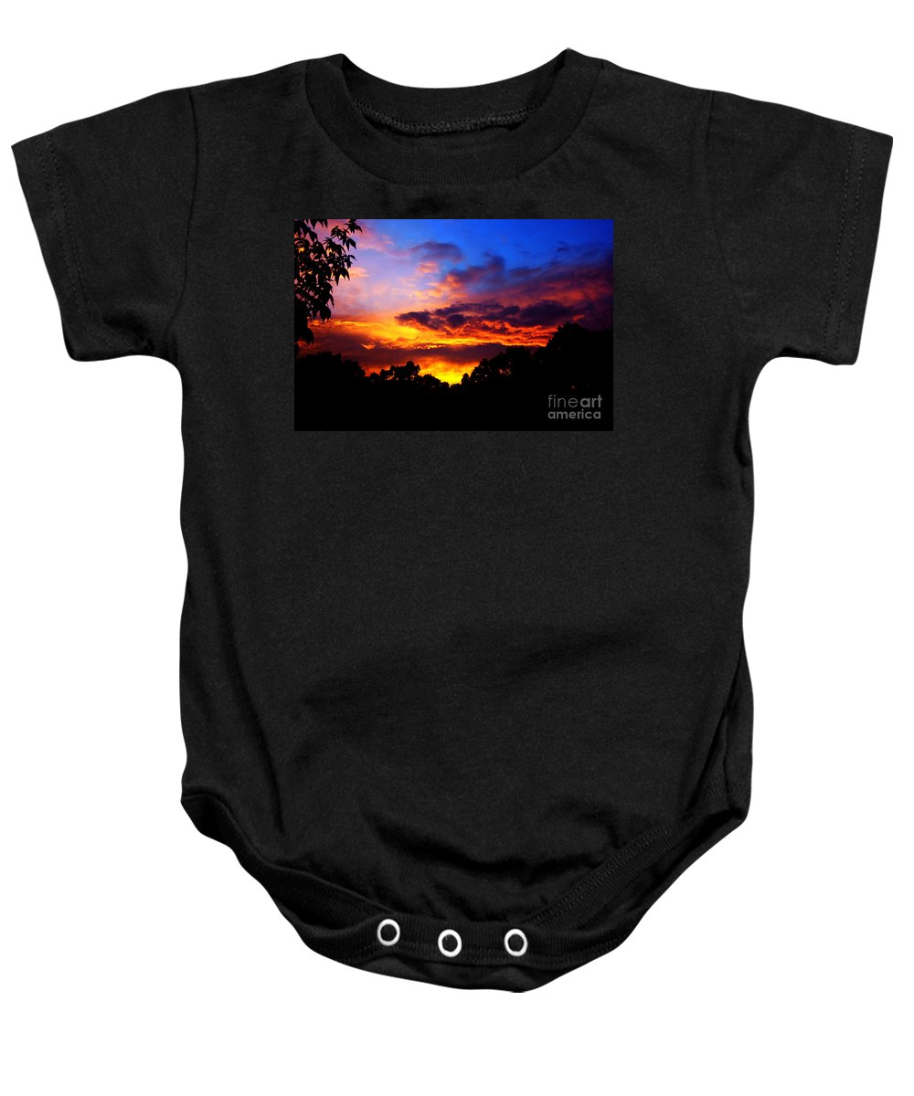 Clay Baby Onesie featuring the photograph Ominous Sunset by Clayton Bruster