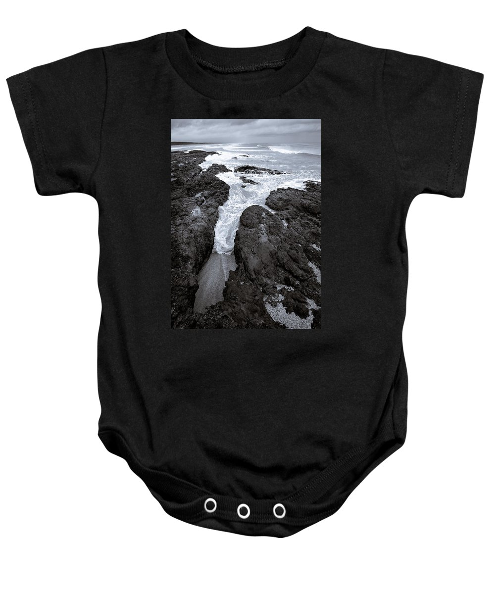 New Zealand Baby Onesie featuring the photograph On The Rocks by Dave Bowman