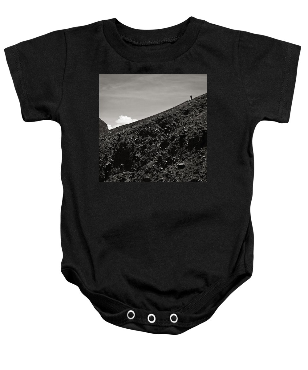Alone Baby Onesie featuring the photograph On The Slope by Konstantin Dikovsky