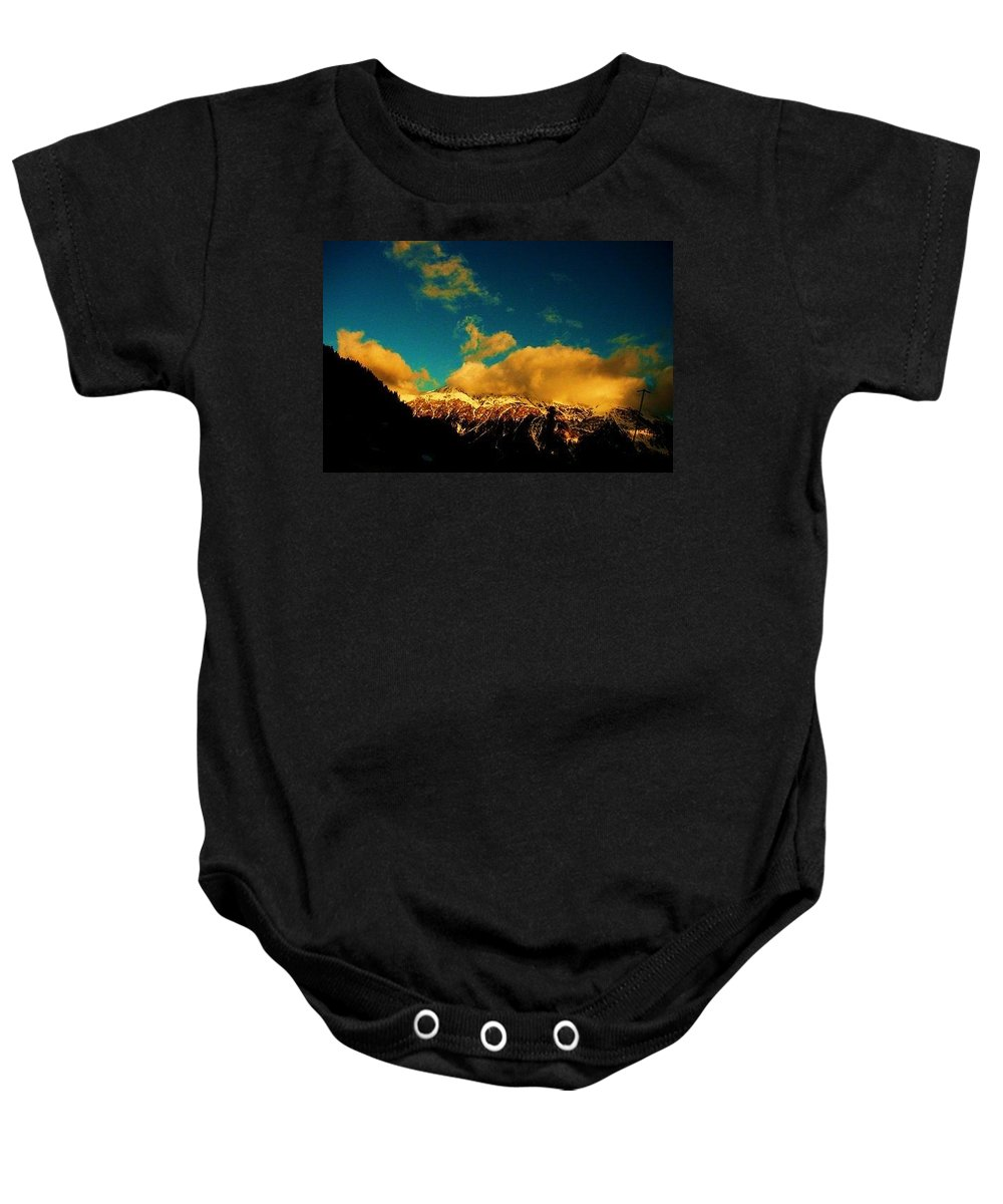 Switzerland Baby Onesie featuring the photograph Ouro by Nila Poduschco