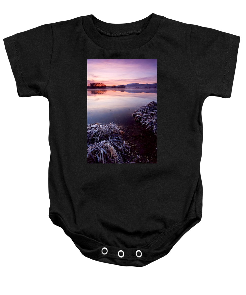 Lake Baby Onesie featuring the photograph Pastel Dawn by Mike Dawson
