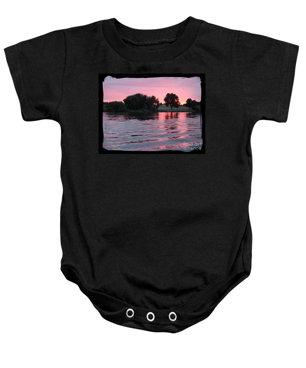 Pink Sunset Baby Onesie featuring the photograph Pink Sunset With Soft Waves In Black Framing by Carol Groenen