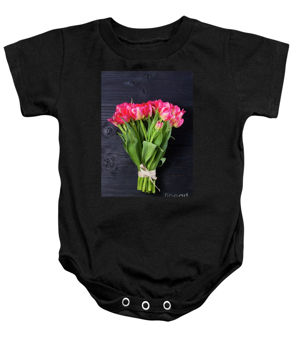 Tulip Baby Onesie featuring the photograph Pink Tulips On Black by Anastasy Yarmolovich