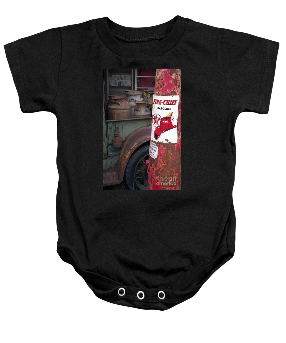 Old Milk Jugs Baby Onesie featuring the photograph Pit Stop by Richard Rizzo
