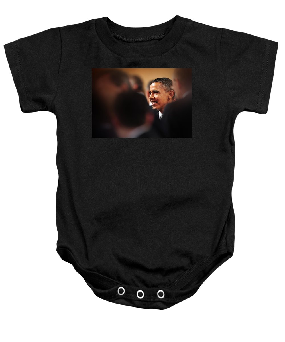 Obama Baby Onesie featuring the photograph President Obama by Rafa Rivas