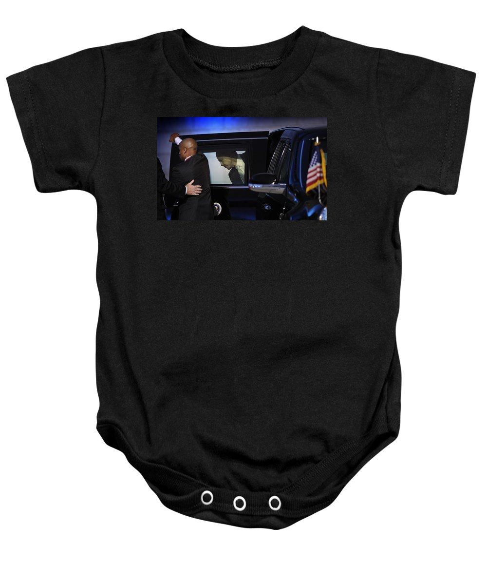 Obama Baby Onesie featuring the photograph President Obama Vi by Rafa Rivas