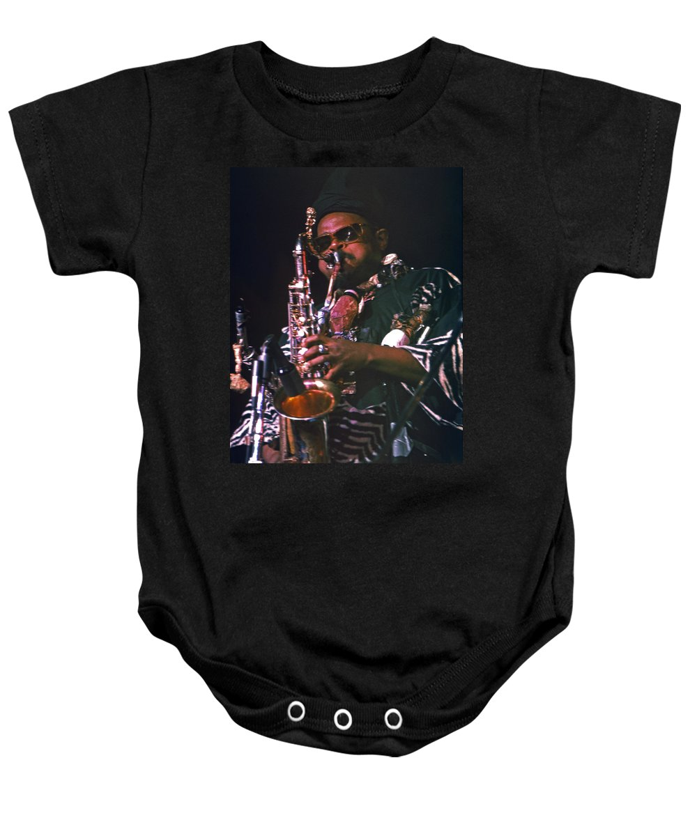 Rahsaan Roland Kirk Baby Onesie featuring the photograph Rahsaan Roland Kirk 4 by Lee Santa