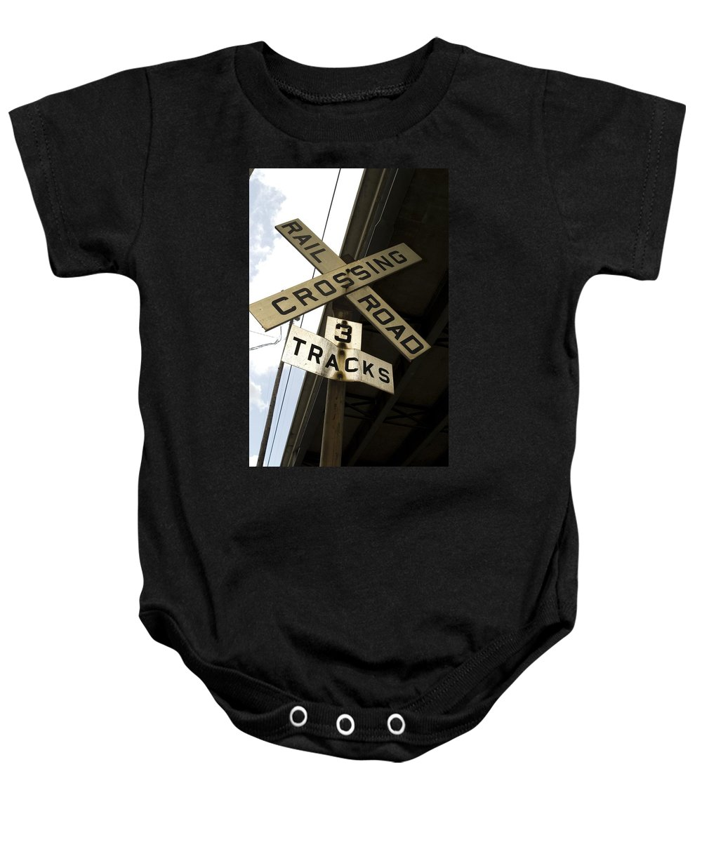 Railroad Sign Baby Onesie featuring the photograph Rail Road Sign by Sara Stevenson