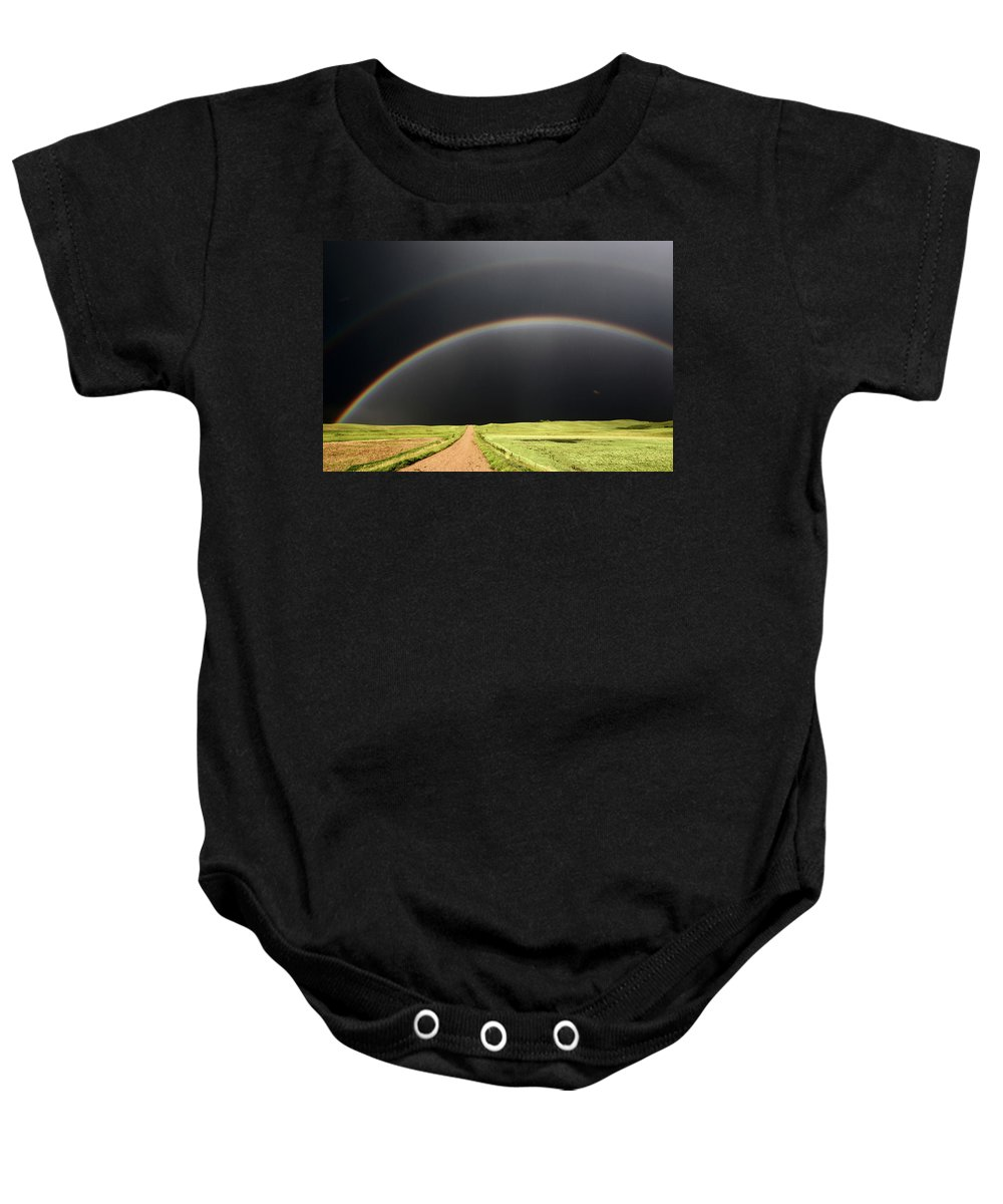 Rainbow Baby Onesie featuring the digital art Rainbow And Darkened Skies Seen Down A Country Road by Mark Duffy