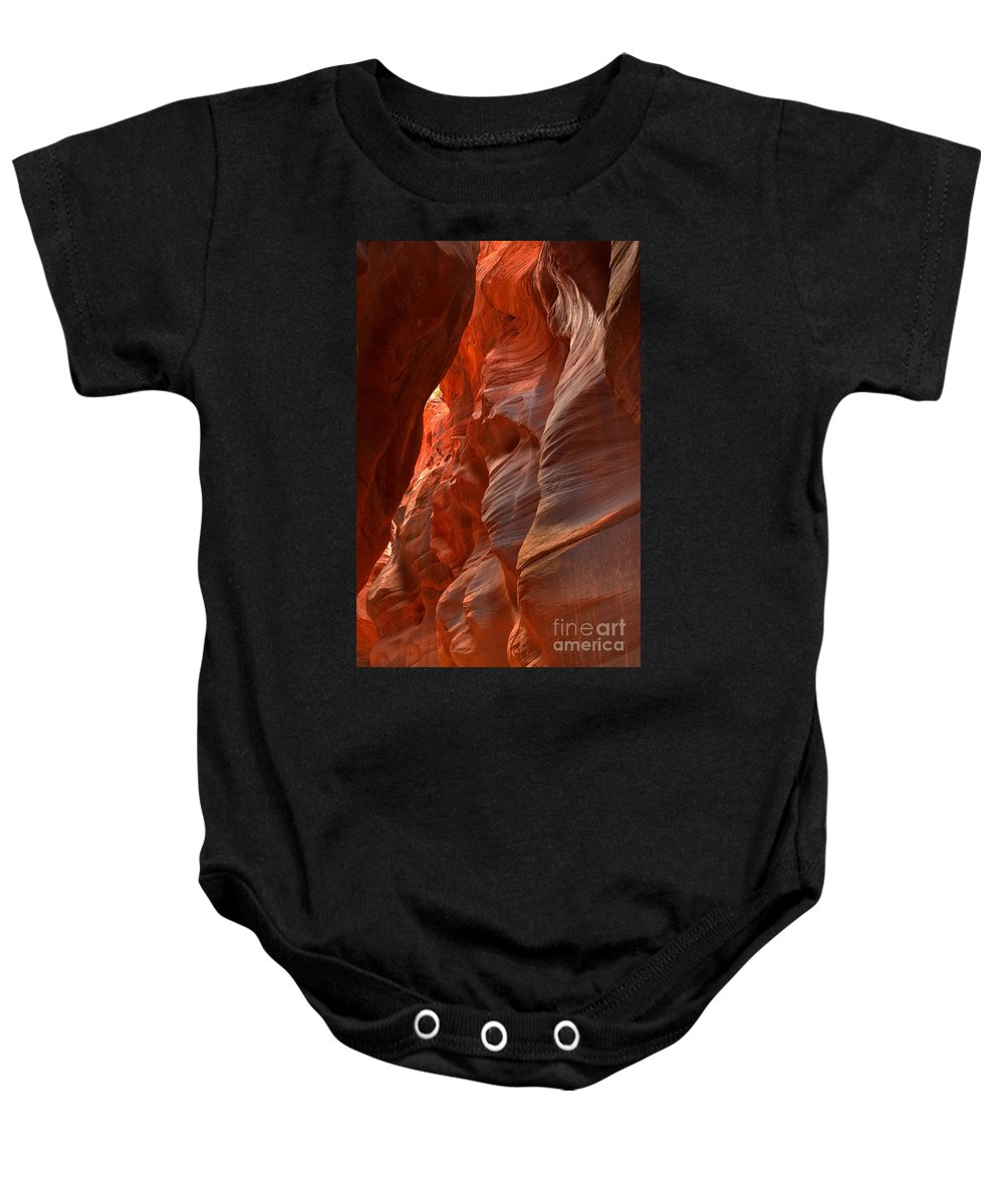 Slot Canyon Baby Onesie featuring the photograph Red And Brown Swirling Sandstone by Adam Jewell