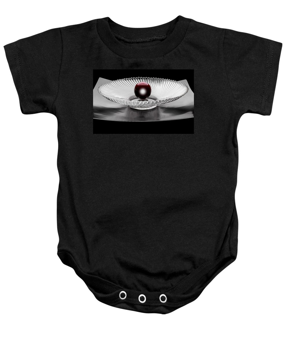 Ball Baby Onesie featuring the photograph Red Ball by Manfred Lutzius