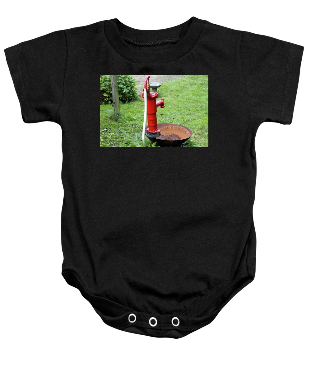 Bright Baby Onesie featuring the photograph Red Water Pump by Bernard Barcos