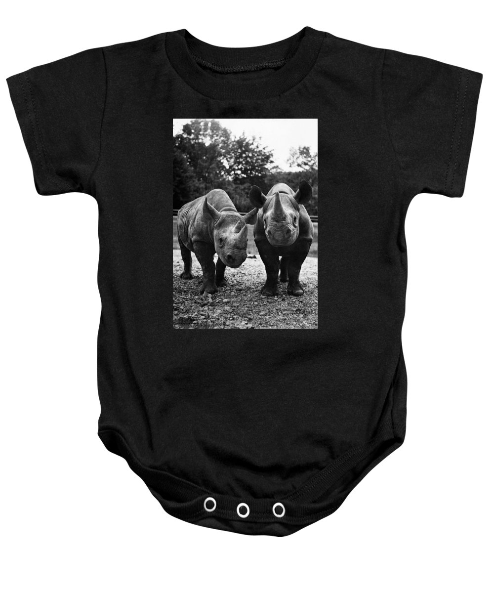 20th Century Baby Onesie featuring the photograph Rhinoceroses by Granger