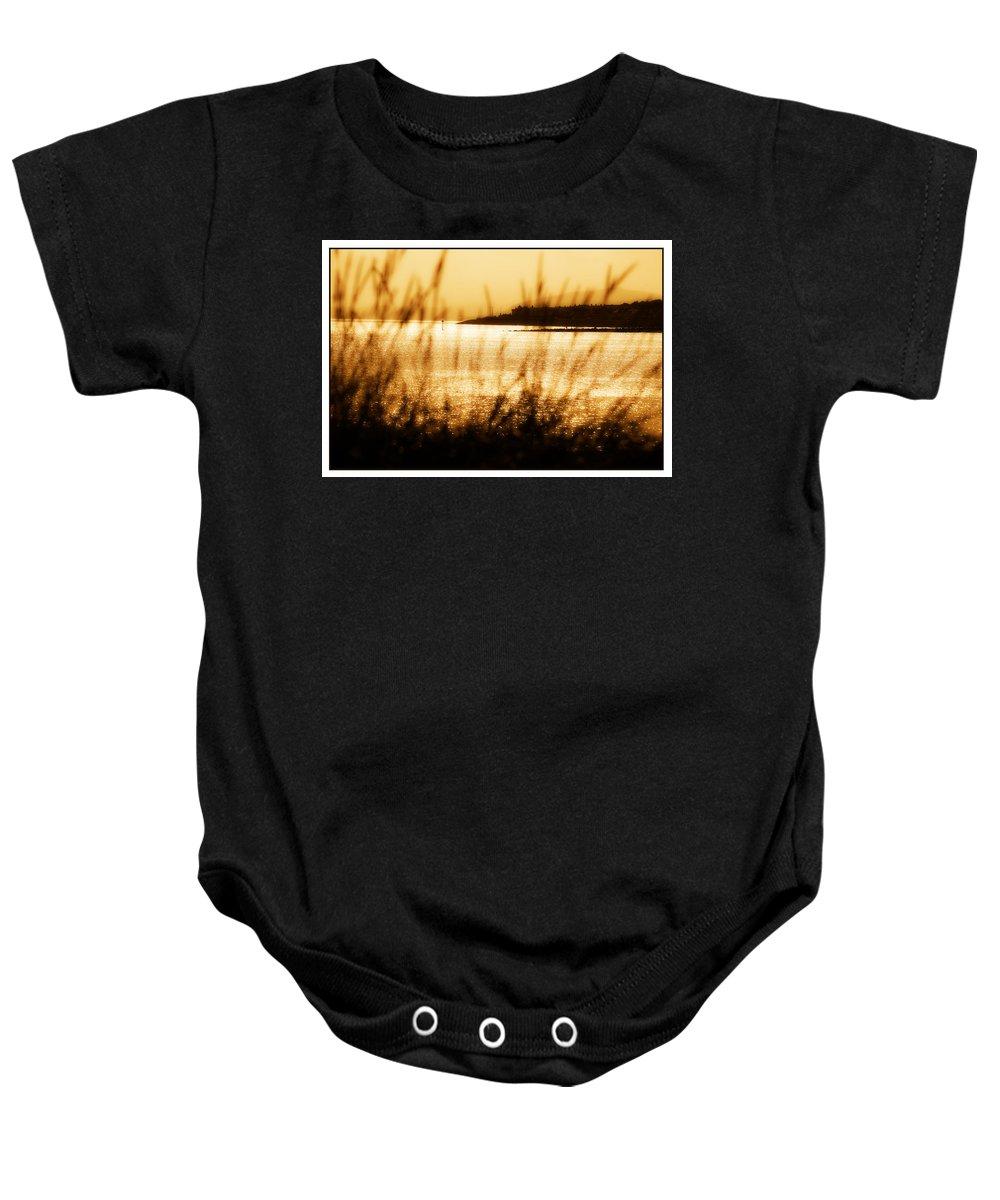 Rhos Baby Onesie featuring the photograph Rhos Point Viewed Through Beach Grass by Mal Bray