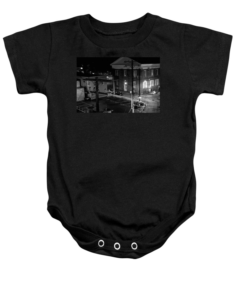 Black White Baby Onesie featuring the photograph Rooftop Court by Jean Macaluso