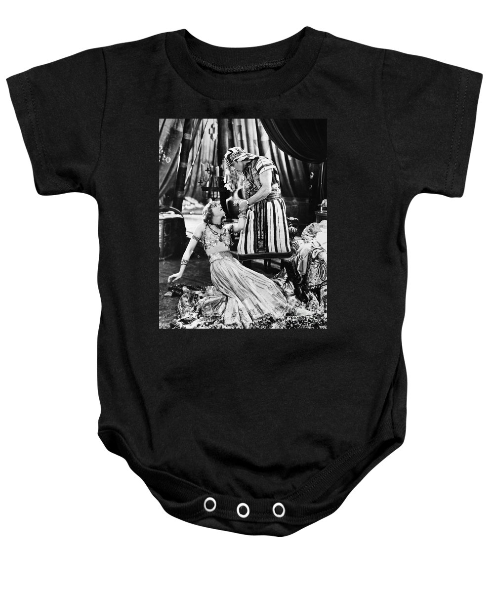 -nec12- Baby Onesie featuring the photograph Rudolph Valentino by Granger