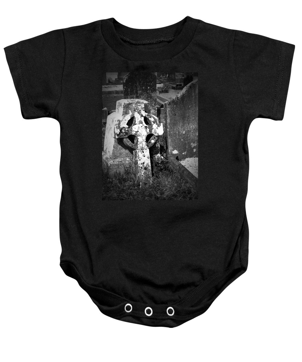 Celtic Baby Onesie featuring the photograph Rugged Cross At Fuerty Cemetery Roscommon Ireland by Teresa Mucha