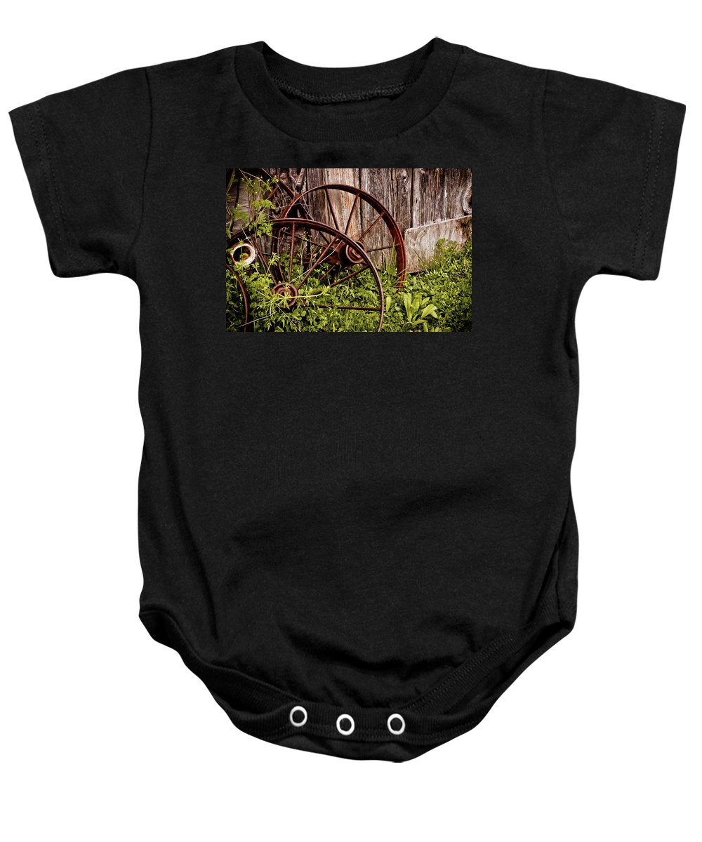 Texas Baby Onesie featuring the photograph Rusty Wheels by Jill Smith