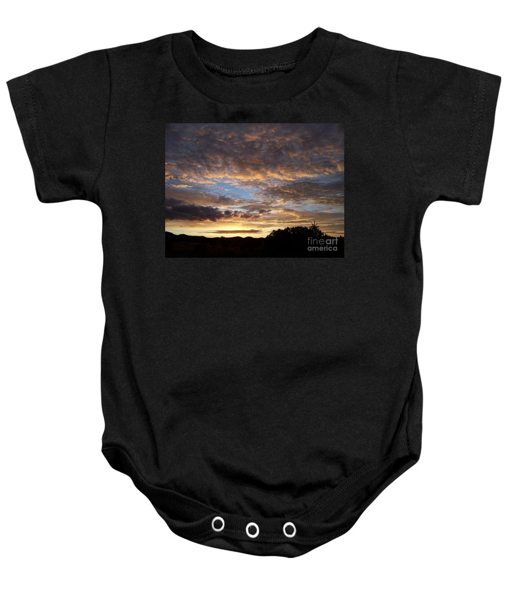 Sunrise Baby Onesie featuring the photograph Santa Fe Sunrise by Brian Commerford