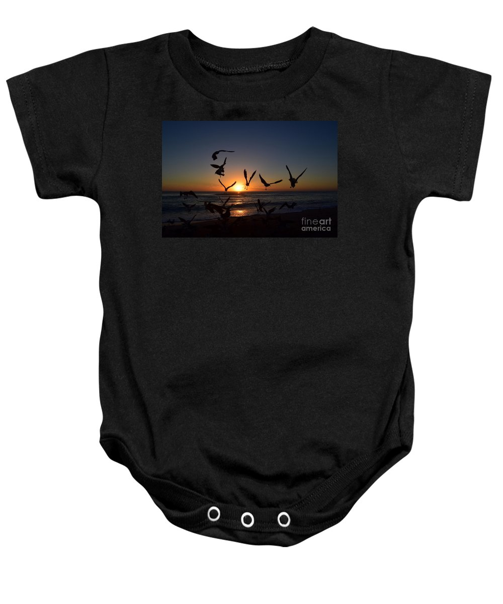Sunrise Baby Onesie featuring the photograph Seagulls Silhouettes by Agnes Lankus