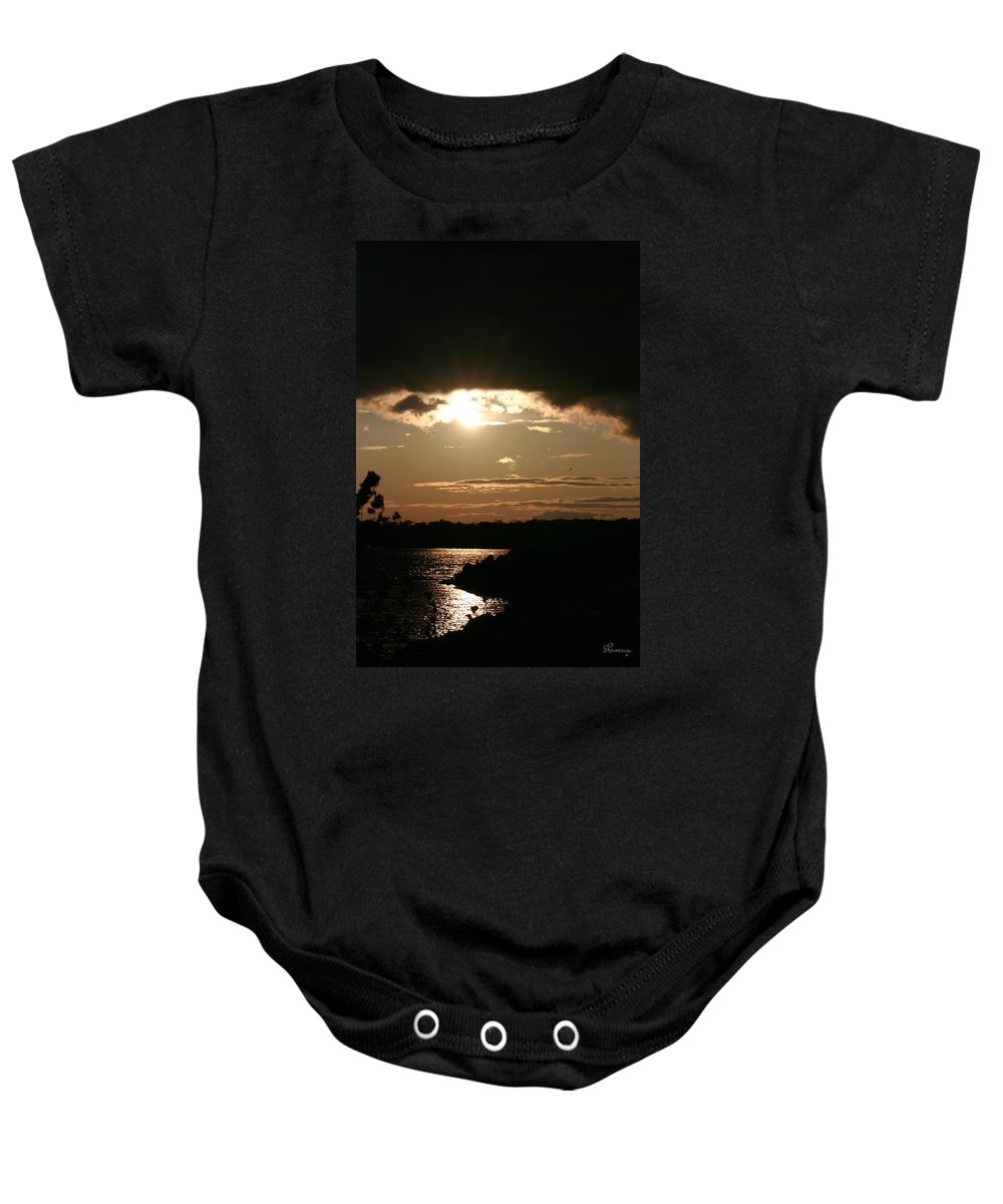 Sunset Lake Water Trees Rocks Shore Clouds Baby Onesie featuring the photograph Setting Sun by Andrea Lawrence