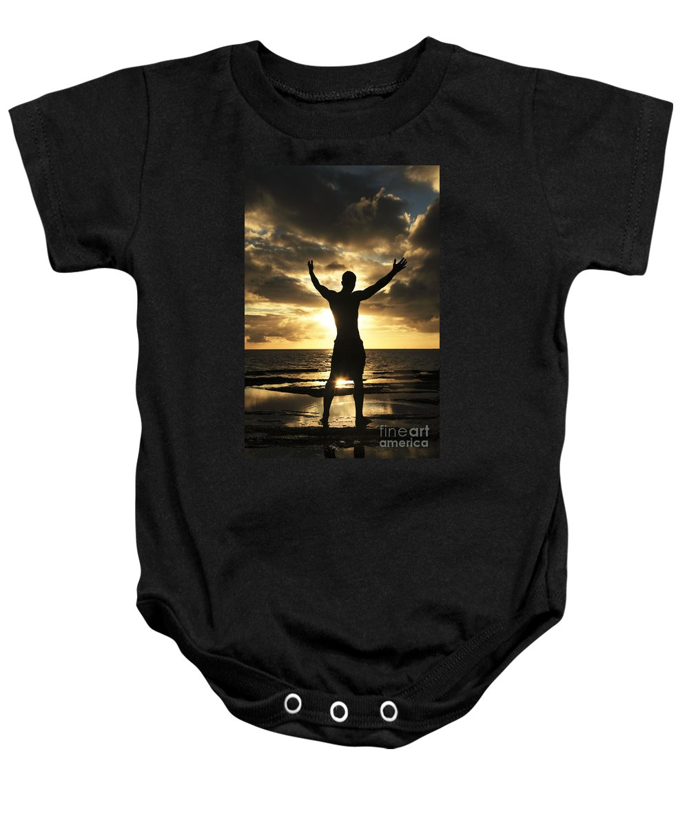 Alone Baby Onesie featuring the photograph Silhouette Of Fit Man by Brandon Tabiolo - Printscapes