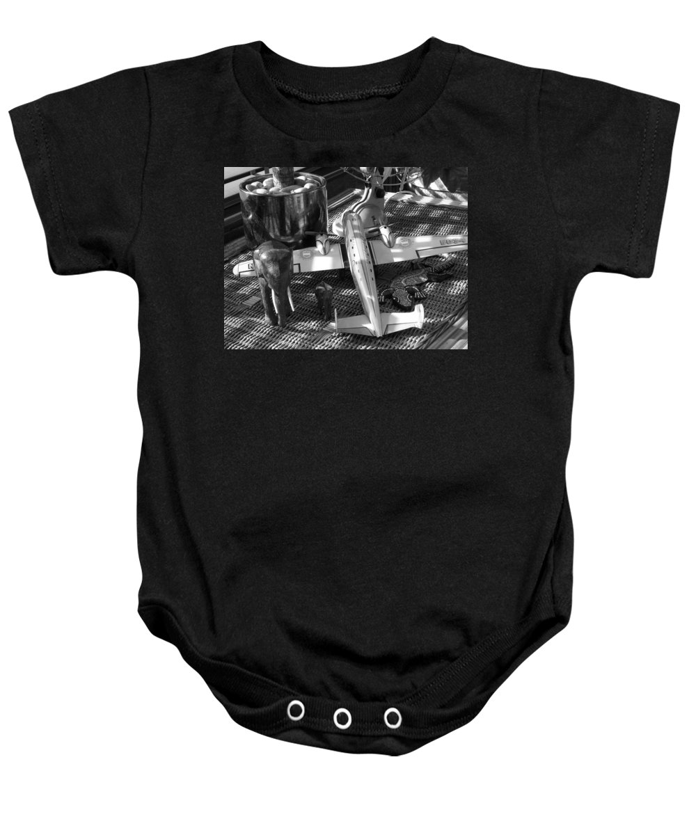 Still Life Baby Onesie featuring the photograph Skycruiser by Charles Stuart