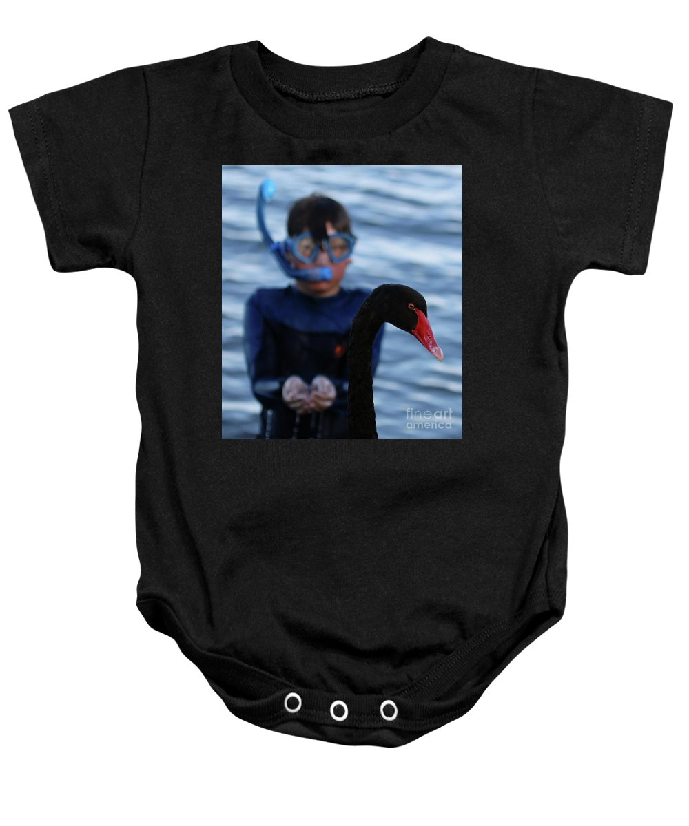 Black Swan Baby Onesie featuring the photograph Small Human Meets Black Swan by Carolyn Parker