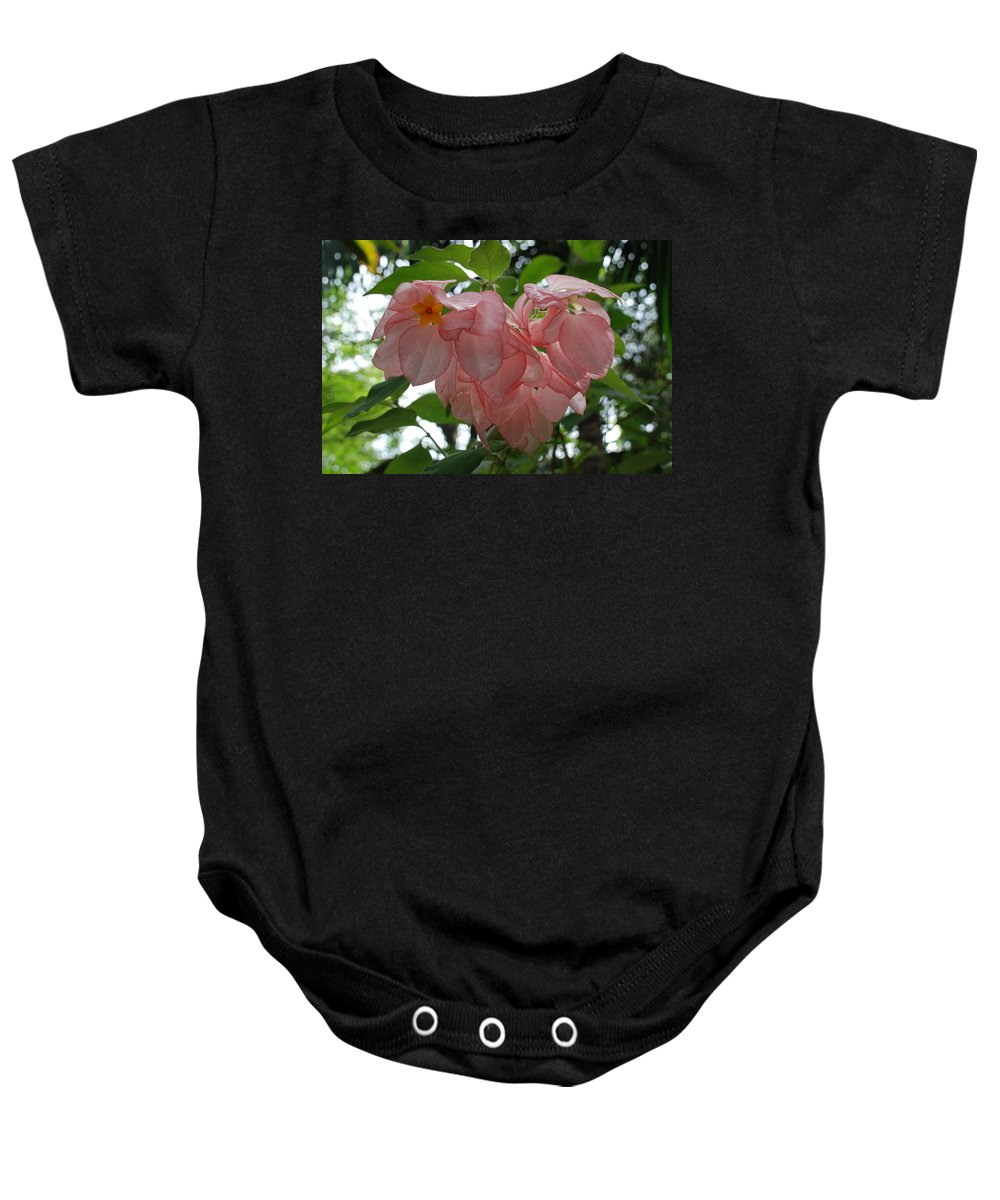 Orange Baby Onesie featuring the photograph Small Orange Flower Pink Heart Leaves by Rob Hans