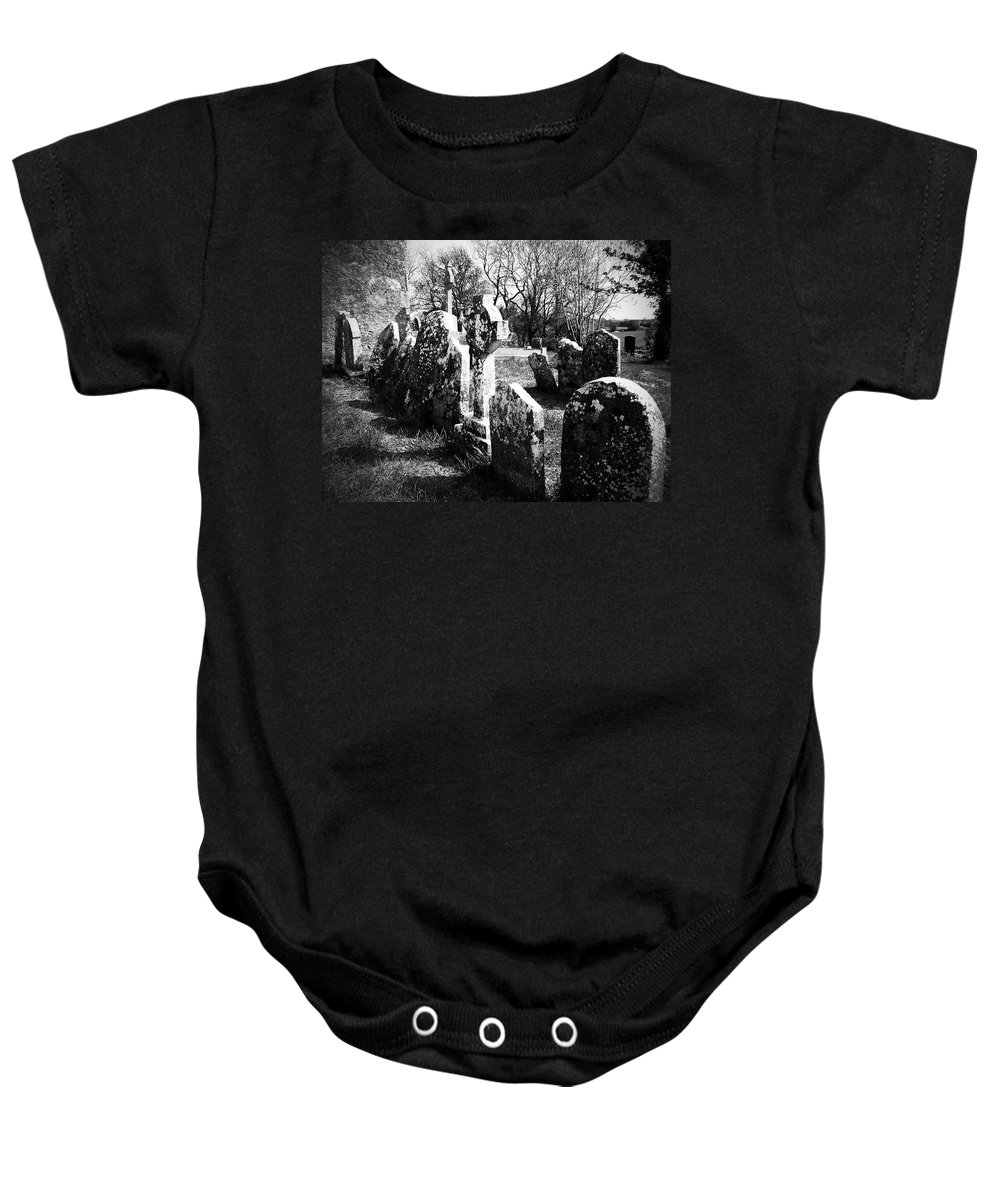 Ireland Baby Onesie featuring the photograph Solitary Cross At Fuerty Cemetery Roscommon Irenand by Teresa Mucha
