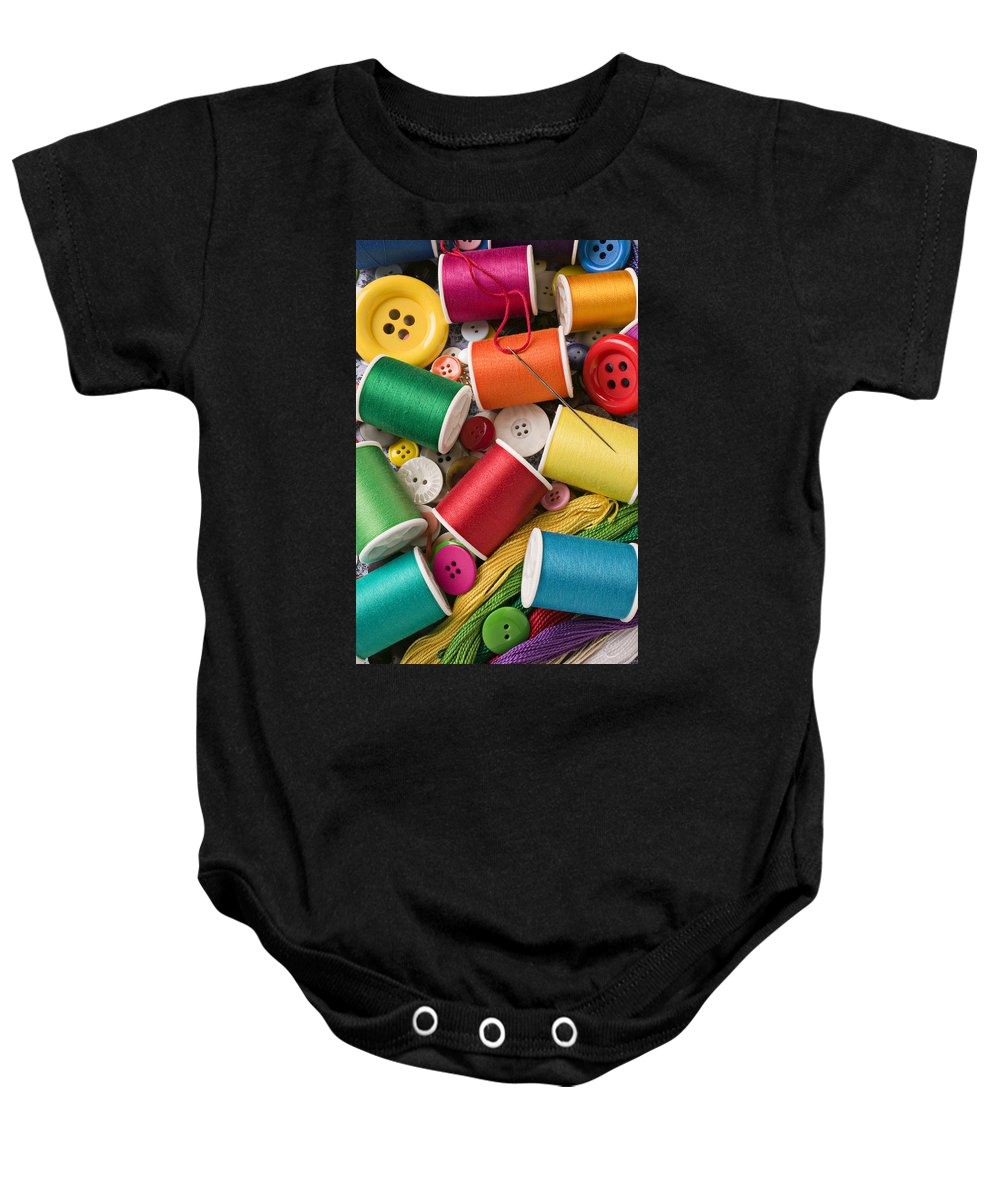 Spools Baby Onesie featuring the photograph Spools Of Thread With Buttons by Garry Gay
