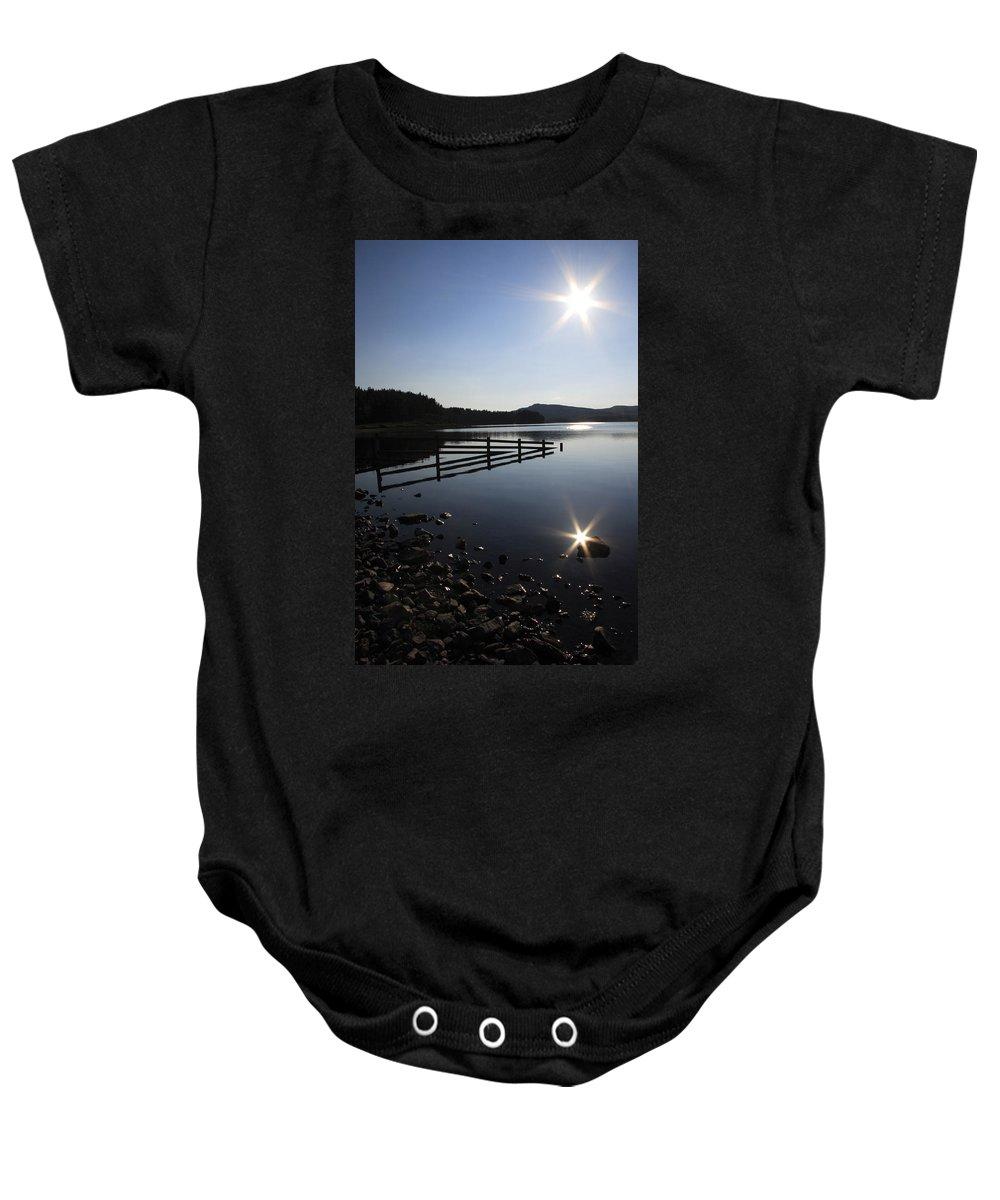 Sun Baby Onesie featuring the photograph Starburst by Phil Crean