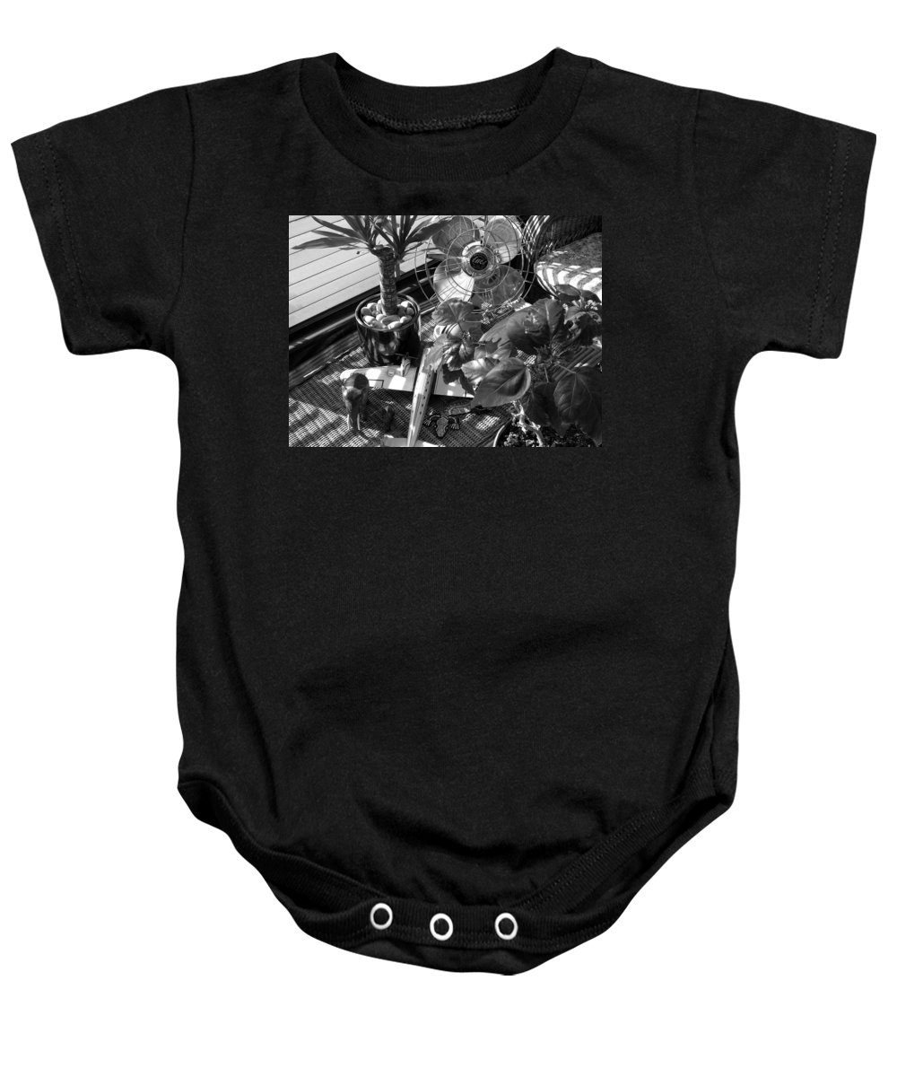 Still Life Baby Onesie featuring the photograph Still Life With Salamander by Charles Stuart