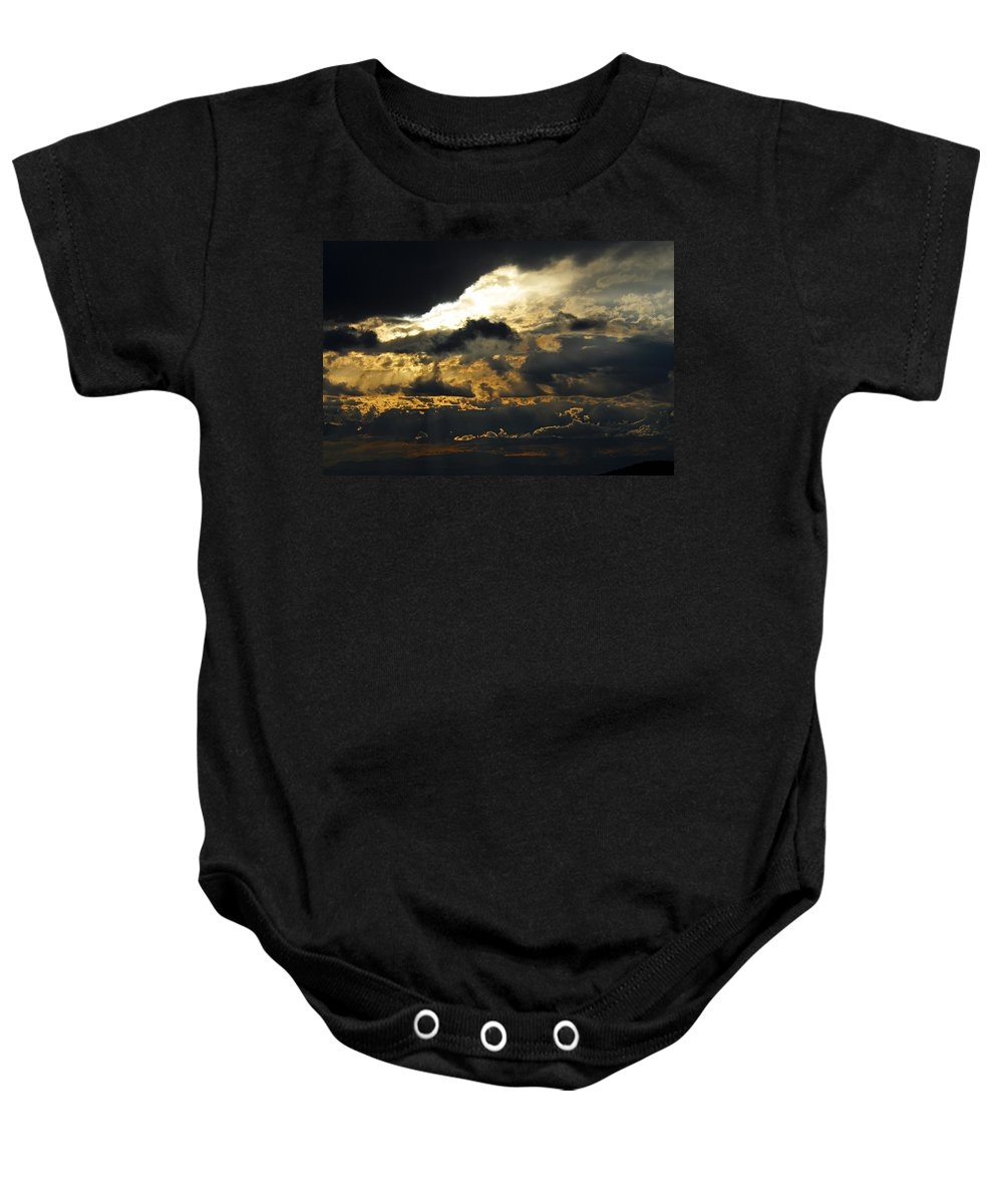 Storm Clouds Baby Onesie featuring the photograph Storm Rolling In by Larry Ricker