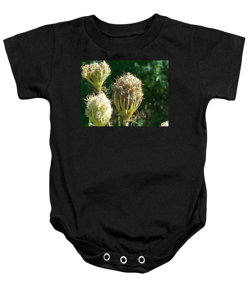Baby Onesie featuring the photograph Strange Flowers by Line Gagne