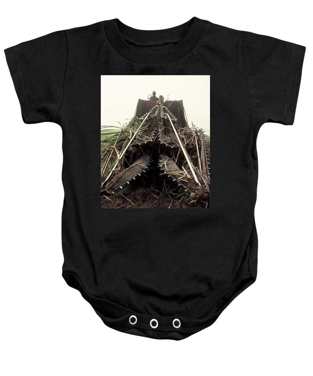 Sugar Cane Baby Onesie featuring the photograph Sugar Cane Cutter by Herman Robert