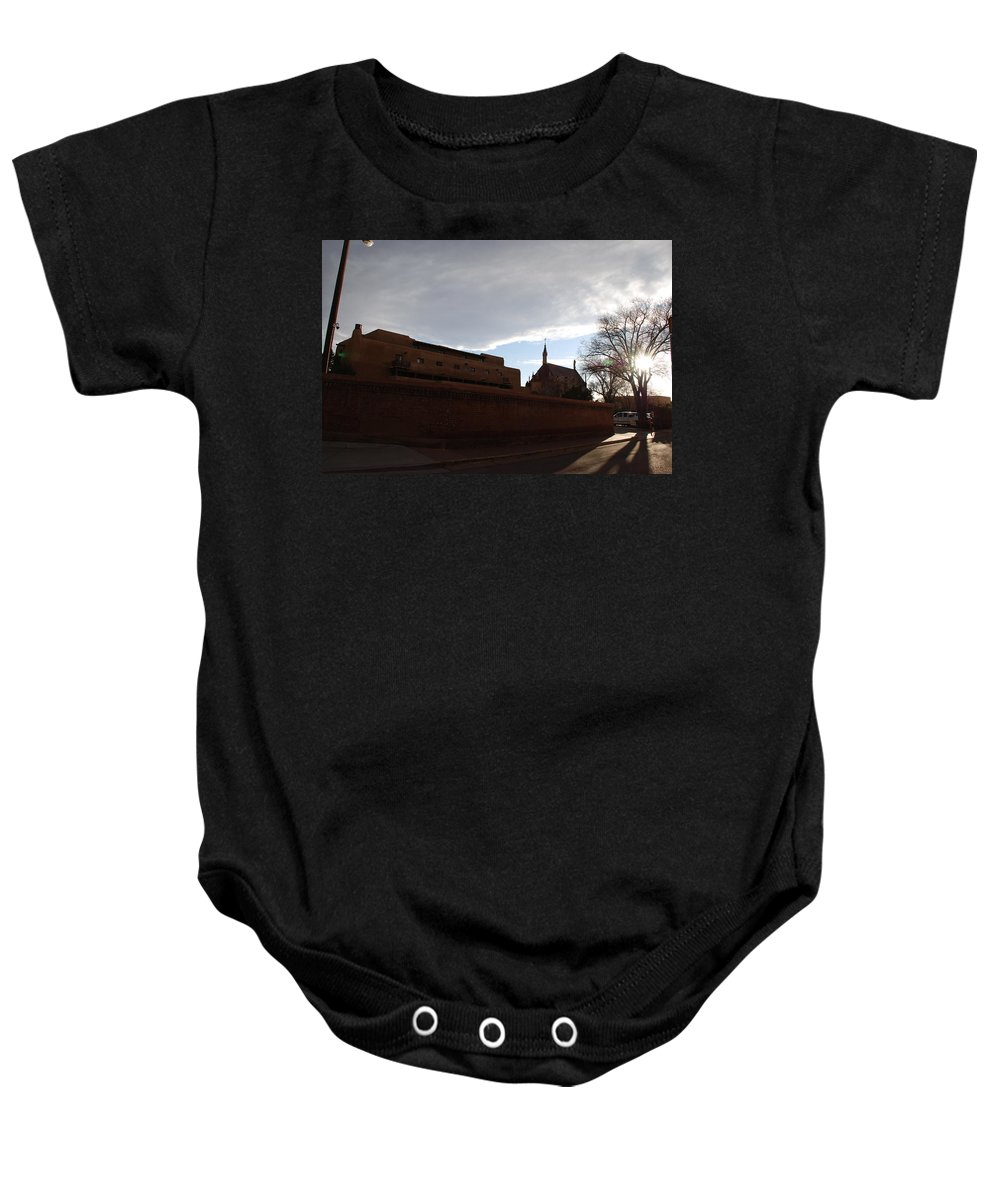 New Mexico Baby Onesie featuring the photograph Sun Thru The Trees by Rob Hans