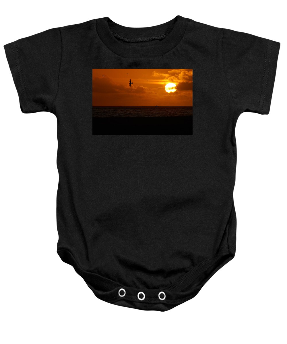 Clay Baby Onesie featuring the photograph Sundown Flight by Clayton Bruster