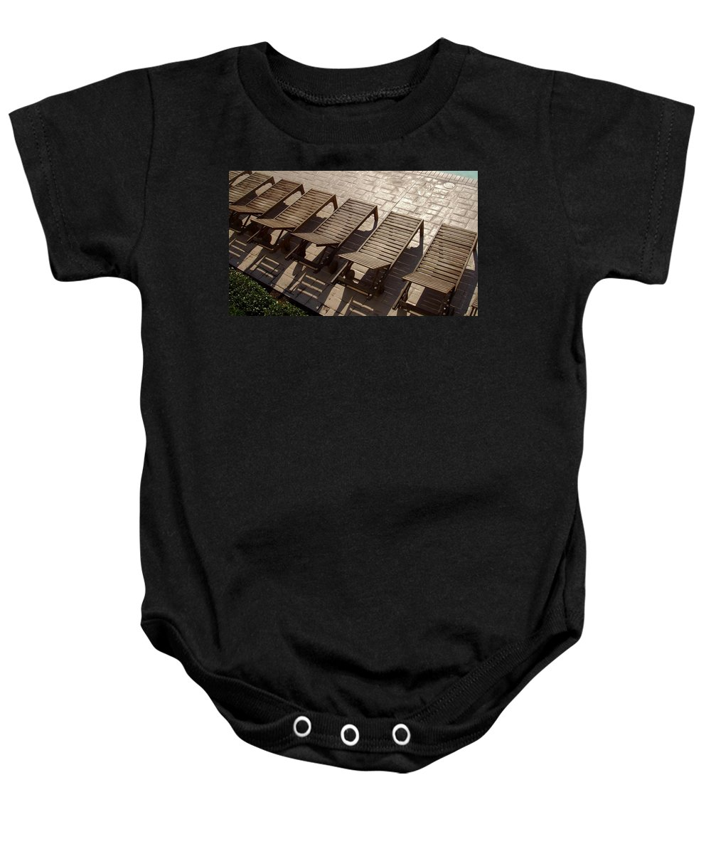 Swimming Pool Baby Onesie featuring the photograph Sunning Chairs by Deborah Crew-Johnson