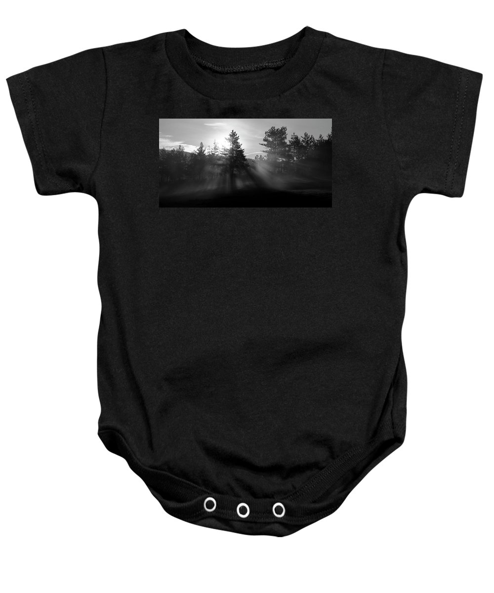 Seasonal Baby Onesie featuring the photograph Sunrise Bursting Through Trees And Mist At Palsko Lake by Ian Middleton