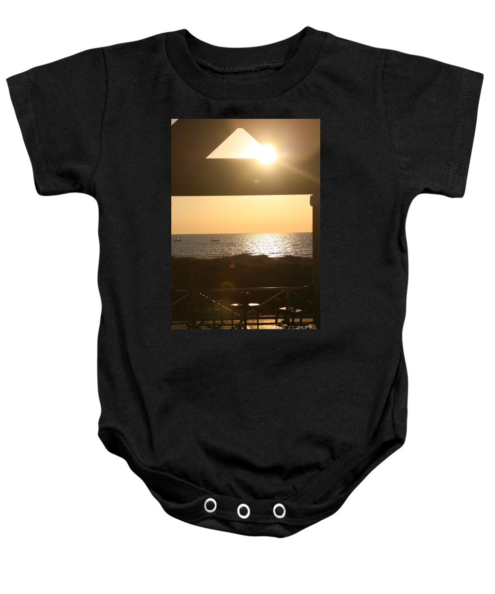 Sunrise Baby Onesie featuring the photograph Sunrise Through The Pavilion by Nadine Rippelmeyer